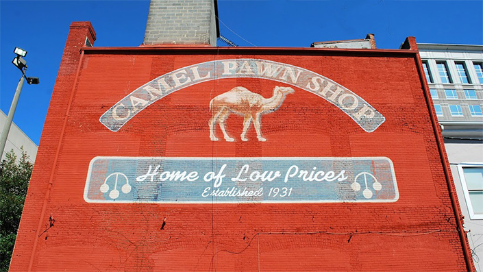 In recent years Camel Pawn was presented the Downtown Excellence Award from the Downtown Winston-Salem Association for rehabilitating old buildings.